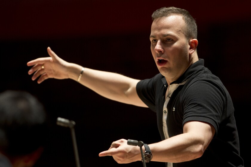 """FILE - In this Oct. 17, 2012, file photo, the Philadelphia Orchestra rehearses with its new music director and conductor Yannick Nezet-Seguin at the Kimmel Center, in Philadelphia. A new documentary, """"Yannick: An Artist's Journey,"""" charts the rise of Metropolitan Opera music director from a school stage to chief conductor at one of the world's great opera houses. (AP Photo/Matt Rourke, File)"""