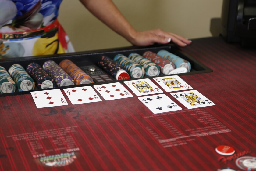 Learning how to play pai gow at San Diego's Casino Institute.