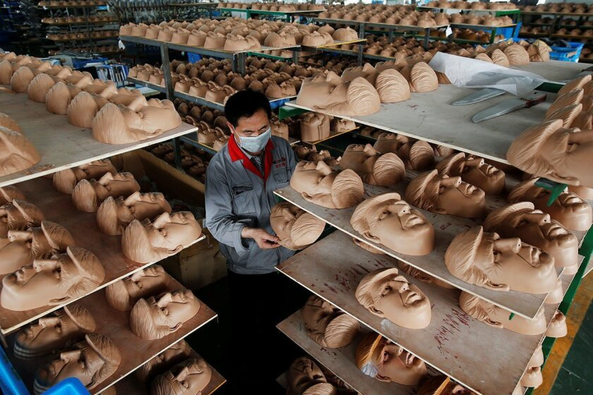 A worker checks a mask of U.S. Republican presidential candidate Donald Trump at Jinhua Partytime Latex Art and Crafts Factory in Jinhua, China. Managers of this Chinese factory are expecting Donald Trump to beat his likely rival Hilary Clinton in mask sales.