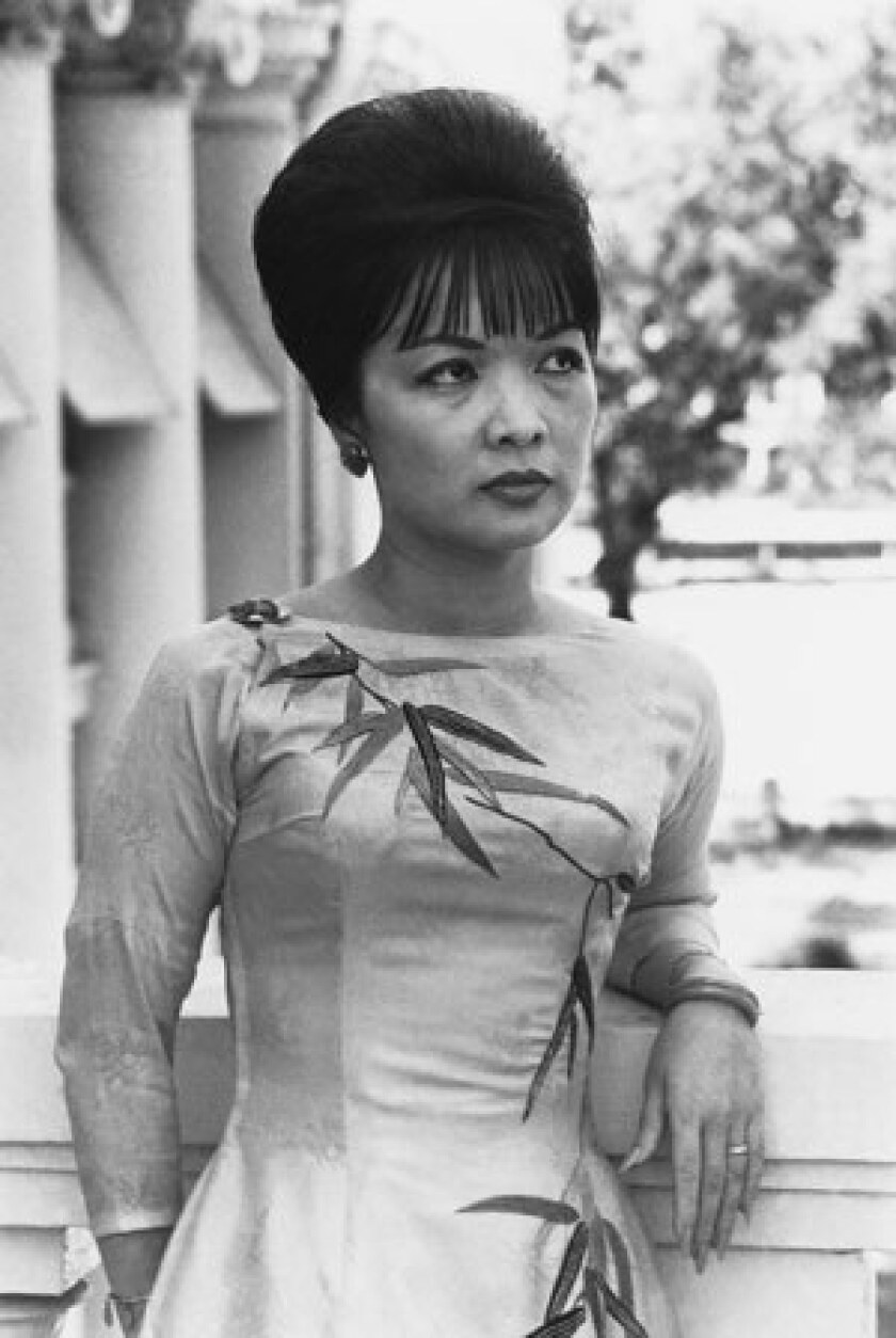 Madame Nhu was known for her bouffant hairdo and glamorous clothes as well as her harsh criticism of protesting Buddhist monks and communist sympathizers.