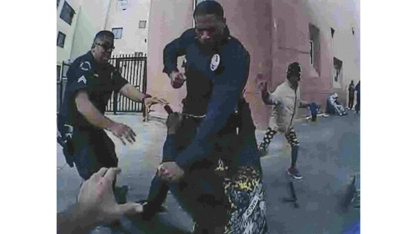 The LAPD provided this image to The Times, saying it showed Charly Keunang grabbing an officer's holstered gun in the moments before Keunang was fatally shot by police. The LAPD said the image was captured by another officer's body camera and later enhanced for analysis.
