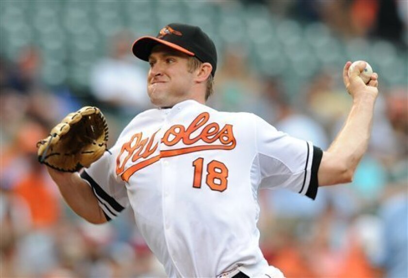 Baltimore Orioles pitcher Garrett Olson delivers against the Los Angeles Angels in the first inning of a baseball game Sunday, July 27, 2008, in Baltimore.(AP Photo/Gail Burton).