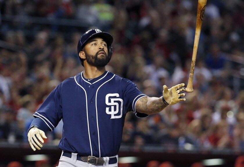 The Padres' Matt Kemp tosses his bat in the air after striking out against the Arizona Diamondbacks during the eighth inning of a baseball game Friday, May 8, 2015, in Phoenix. The Padres defeated the Diamondbacks 6-5.