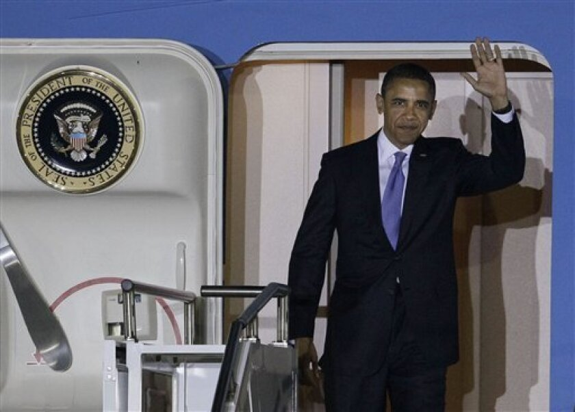 US President Barack Obama arrives at the Seoul Airport to attend the G-20 Summit, Wednesday, Nov. 10, 2010 in Seoul, South Korea. Twenty world leaders will come together in Seoul Nov. 11-12 to discuss the state of the global economy as it emerges from the financial crisis. (AP Photo/Wally Santana)