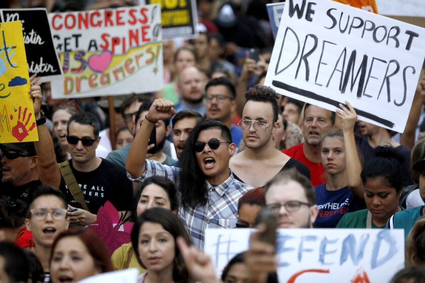 Protesters gather to demonstrate against changes in the Deferred Action for Childhood Arrivals (DACA) immigration policy at City Hall in Los Angeles on Sept. 5, 2017.
