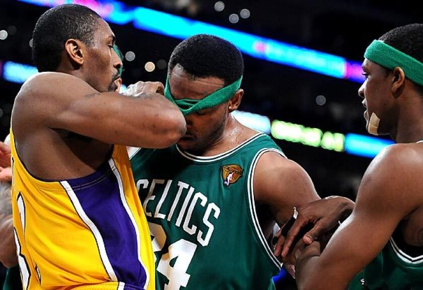 Lakers forward Ron Artest and Celtics forward Paul Pierce go face to face after getting tangled while battling for rebounding position in the first half of Game 7 of the 2010 NBA Finals.