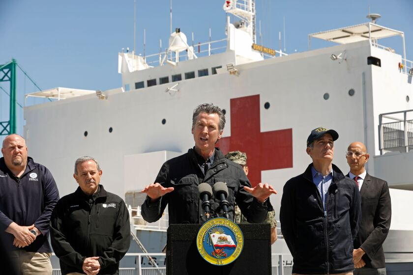 California Gov. Gavin Newsom speaks in front of the hospital ship USNS Mercy after it arrived into the Port of Los Angeles on March 27.