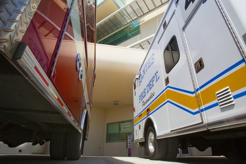 Paramedic vehicles are parked outside of Sharp Grossmont Hospital's emergency department. / photo by Nelvin C. Cepeda * U-T