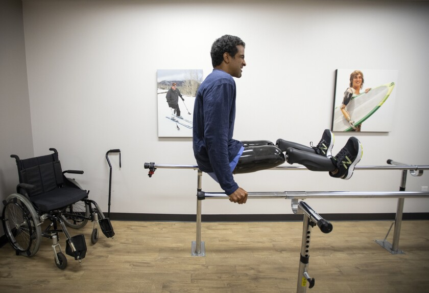 Obi Ndefo tests his new high-tech prosthetic legs at the Hanger Clinic in Los Angeles.