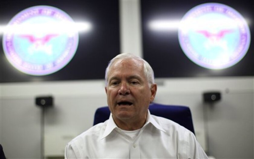 U.S. Secretary of Defense Robert Gates speaks to the media aboard his aircraft over the Pacific Ocean between Hawaii and Singapore, Wednesday, June 2, 2011. Gates is traveling to Asia and Europe on his last foreign trip as Secretary of Defense. (AP Photo/Jason Reed, Pool)