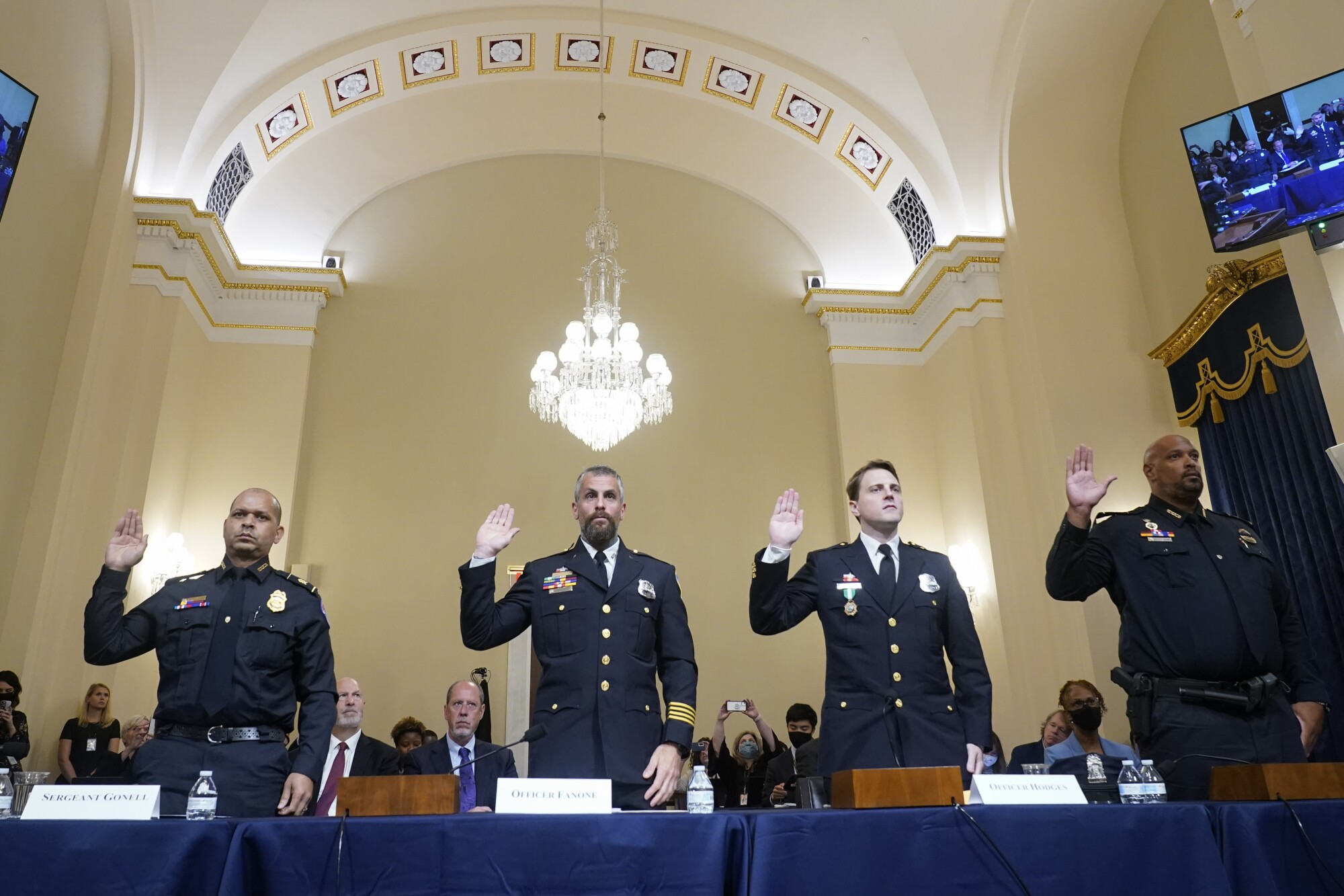 Police officers being sworn in to testify before a House hearing.