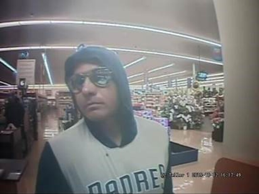Authorities released this surveillance photograph of a man suspected of robbing a teller Wednesday afternoon at a bank branch inside the Egger Highlands Vons.