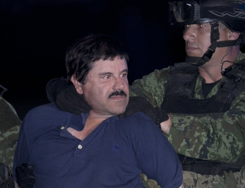 """FILE - In this Jan. 8, 2016 file photo, Joaquin """"El Chapo"""" Guzman is made to face the press as he is escorted to a helicopter in handcuffs by Mexican soldiers and marines at a federal hangar in Mexico City, Mexico. Mexico's Foreign Relations department has ruled that the extradition of Guzman to th"""