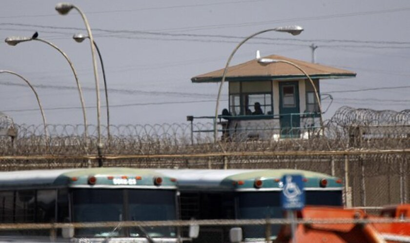 A guard tower at the California state prison in Chino, where 12 inmates have died after testing positive for COVID-19