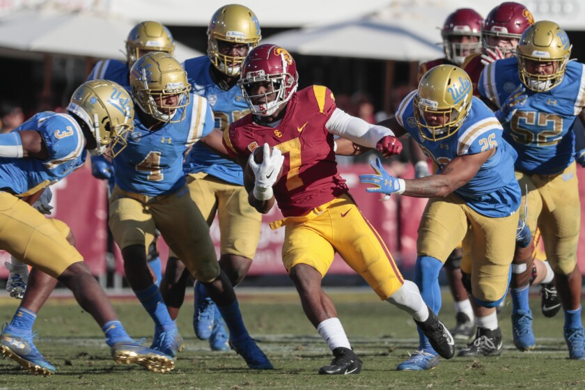 USC running back Stephen Carr runs through the UCLA defense during the second half of the Bruins' loss Saturday.