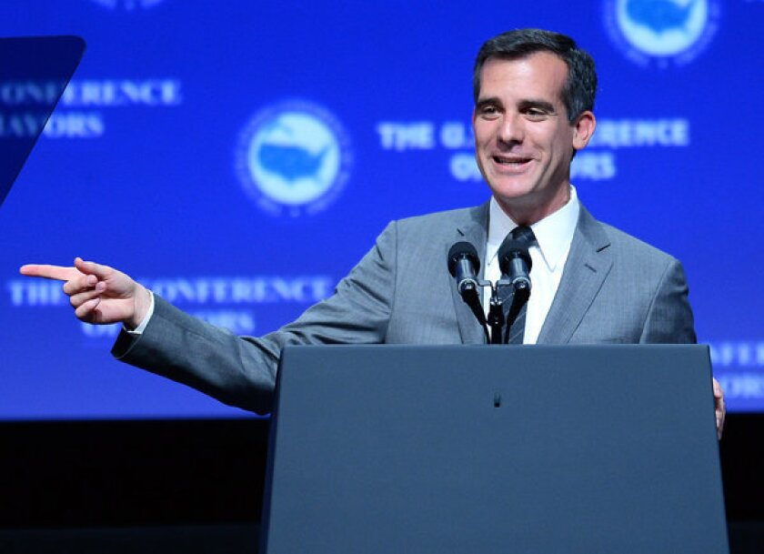 Los Angeles Mayor-elect Eric Garcetti speaks at the 81st annual U.S. Conference of Mayors at the Mandalay Bay Convention Center on June 21 in Las Vegas. His inaugural party will be Sunday.