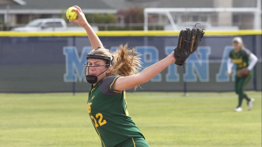 Edison pitcher Jenna Bloom winds up to make a throw in girls varsity softball action at Marina High