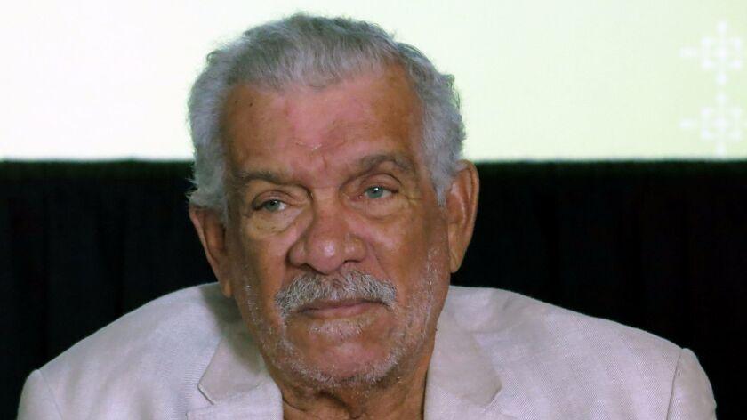 Nobel Prize winner Derek Walcott attends a news conference in Mexico City in 2014.