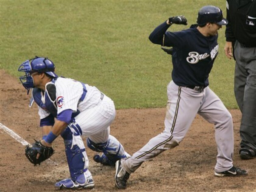 Milwaukee Brewers left fielder Ryan Braun, right, right, pumps his fist after scoring past Chicago Cubs catcher Geovany Soto, left, and off a hit by Corey Hart during the ninth inning of their baseball game and 4-3 win over the Cubs at Wrigley Field in Chicago, Monday, March 31, 2008. (AP Photo/Charles Rex Arbogast)