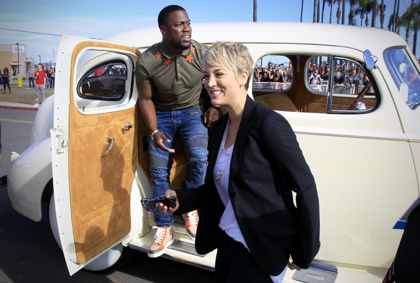 "Actor Kevin Hart, and actress Kaley Cuoco-Sweeting, two of the stars of the upcoming movie, ""The Wedding Ringer,"" arrive at Miramar Marine Corps Air Station for a screening of the movie with Marines and their families."