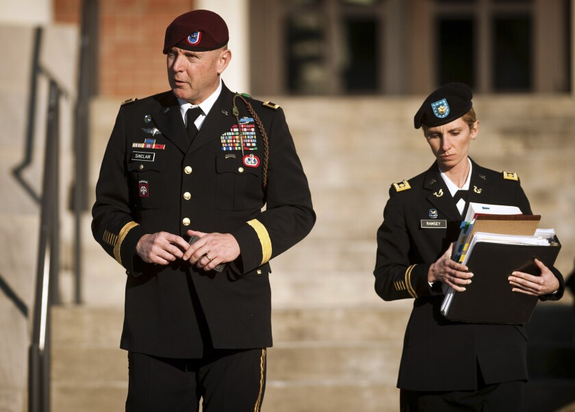 U.S. Army Brig. Gen. Jeffrey A. Sinclair, left, leaves a Ft. Bragg courthouse in January with a member of his defense team, Maj. Elizabeth Ramsey.