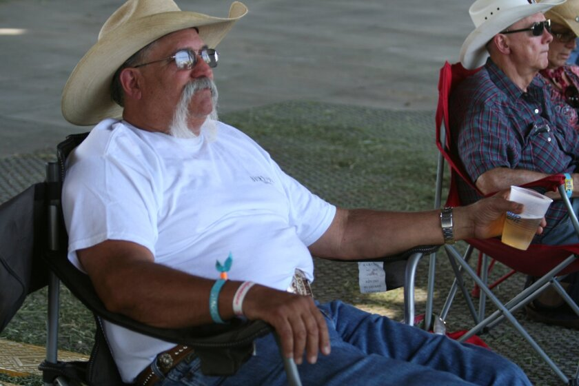 Mike Norman, 60, of Riverside considers himself George Jones' biggest fan at Stagecoach.