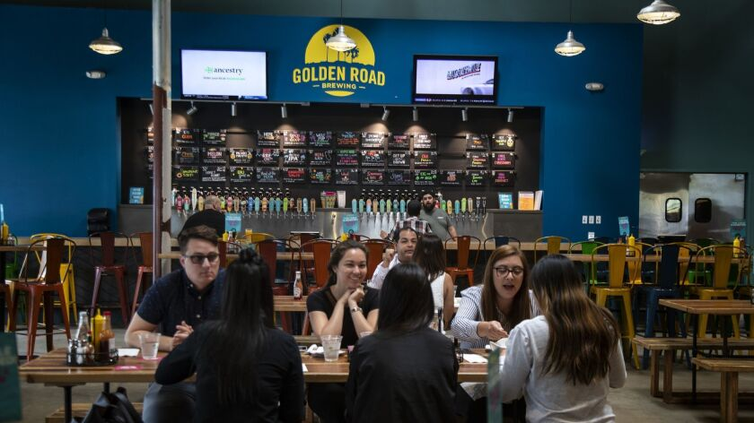 ANAHEIM, CA - APRIL 29, 2019: Customers enjoy lunch at Golden Road Brewery on April 29, 2019 in Ana