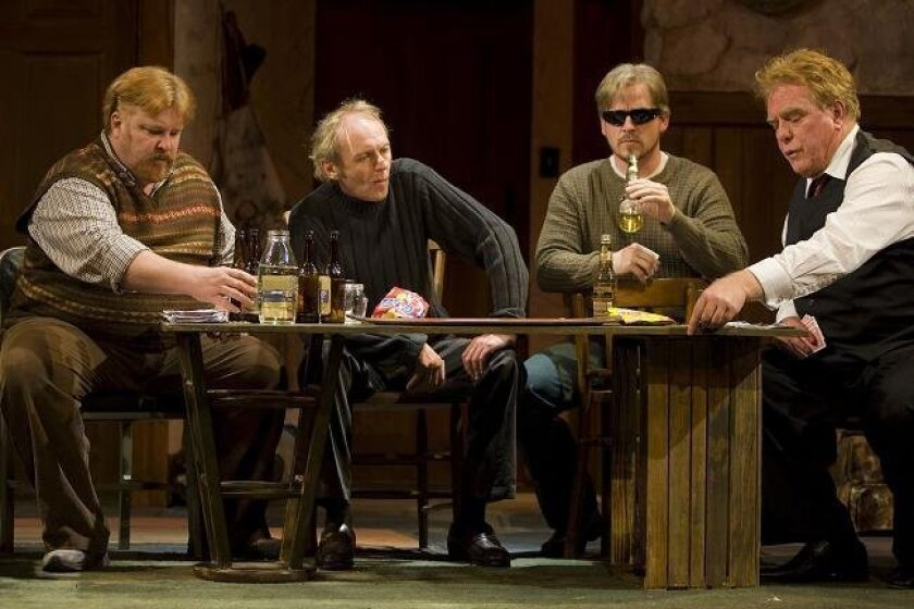 "Playing for keeps, from left: Paul James Kruse (Ivan), Ron Choularton (Sharky), Robert Townsend (Nicky) and Sam Woodhouse (Mr. Lockhart) in San Diego Repertory Theatre's ""The Seafarer."" (Photo by J. Katarzyna Woronowicz)"