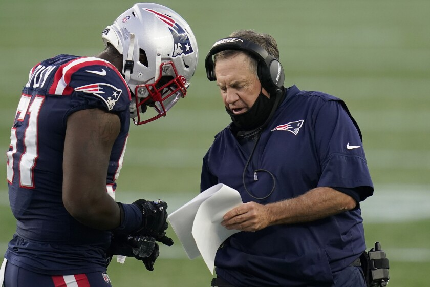 New England Patriots head coach Bill Belichick, right, gives instructions to linebacker Ja'Whaun Bentley (51) in the first half of an NFL football game against the San Francisco 49ers, Sunday, Oct. 25, 2020, in Foxborough, Mass. (AP Photo/Charles Krupa)