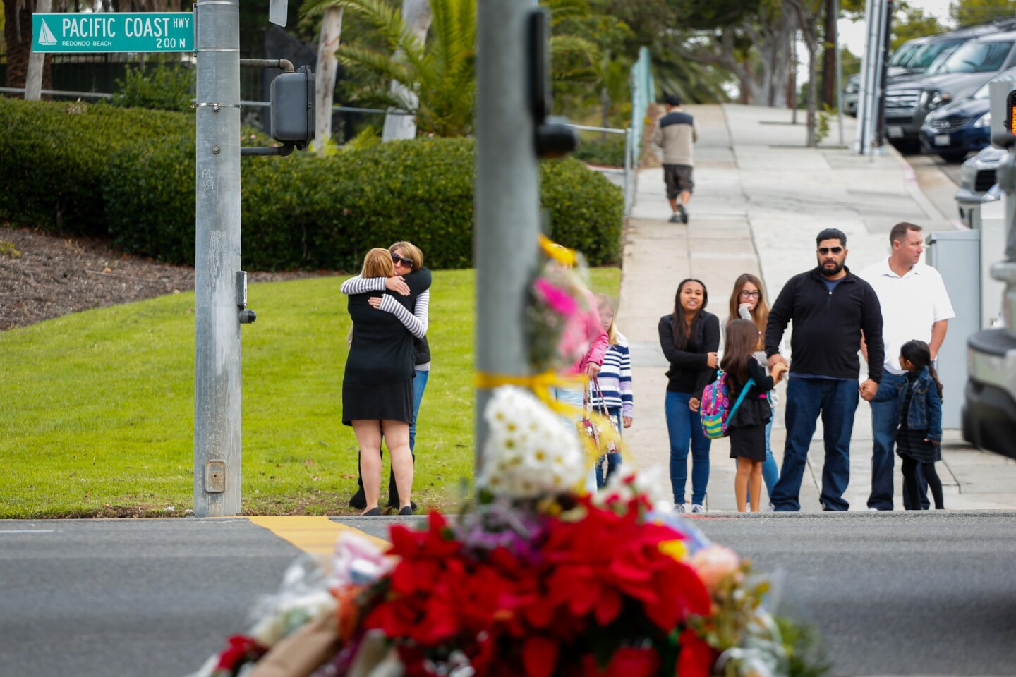 People dropped flowers and stopped at the corner of Vincent Street and Pacific Coast Highway in Redondo Beach near the site of the fatal accident.