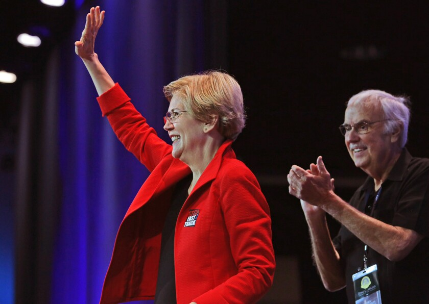 Massachusetts Sen. Elizabeth Warren takes the stage with party Chairnan John Burton at the California Democratic Party Convention on Saturday.
