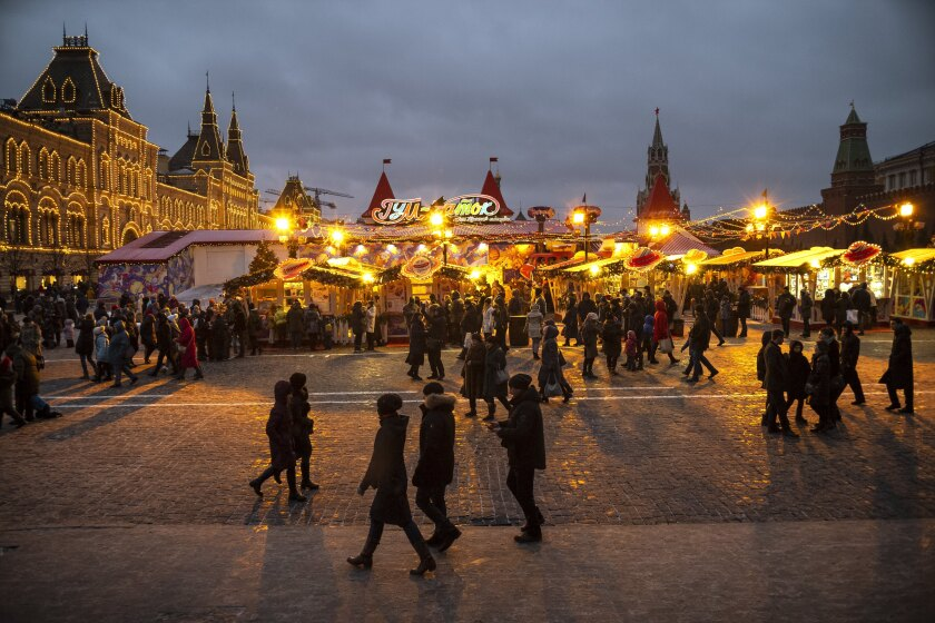 People shop at a holiday market on Moscow's Red Square.