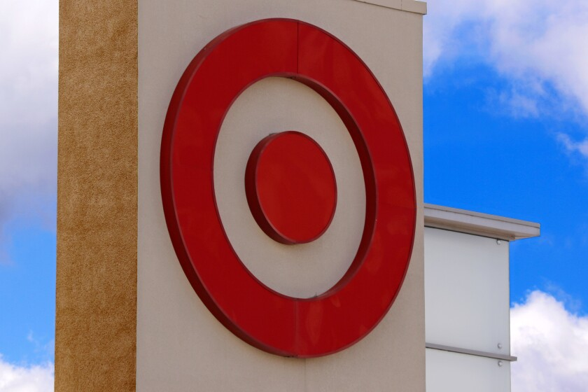 FILE- This May 3, 2017, file photo shows the Target logo on a store in Upper Saint Clair, Pa. Target Corp. reports financial results on Tuesday, March 6, 2018.