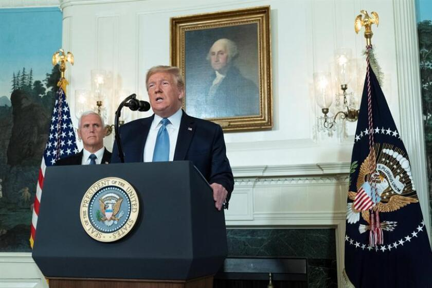 President Donald Trump makes a statement at the White House in Washington on 05 August 2019 in response to two separate shooting incidents, with Vice President Mike Pence looking on. EFE/EPA/Chris Kleponis / POOL