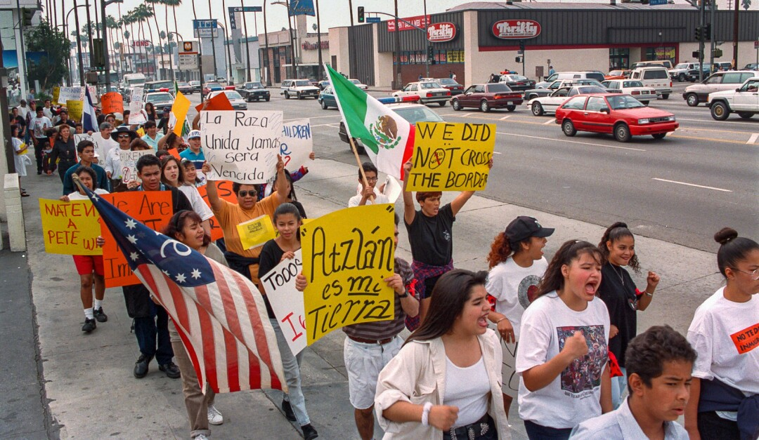 Students hold banners and flags during a walk-a-thon