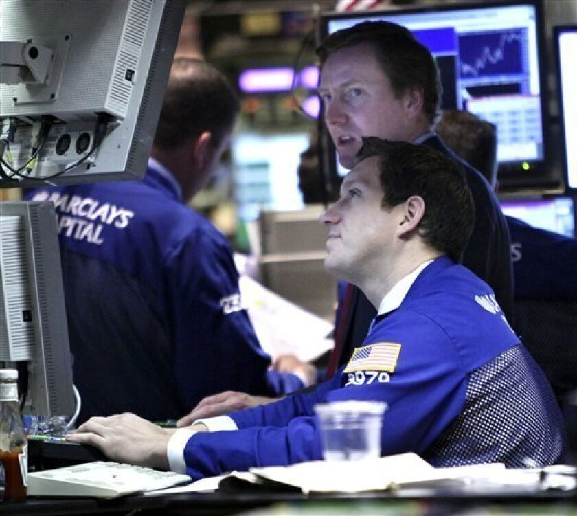In this Nov. 4, 2010 photo, traders work on the floor to the New York Stock Exchange, in New York.(AP Photo/Mary Altaffer)