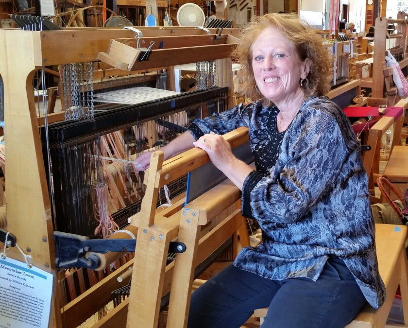 """Tyler Orion at her loom. """"You can't use a cellphone while you are weaving,"""" she notes; instead, """"You become one with the process."""""""