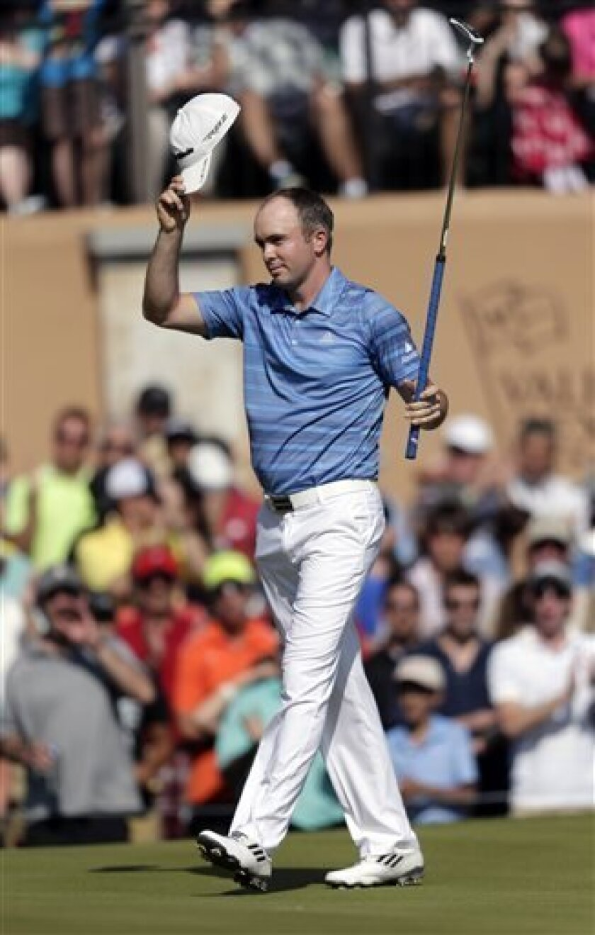 Martin Laird, of Scotland, reacts after winning the Texas Open golf tournament, Sunday, April 7, 2013, in San Antonio. (AP Photo/Eric Gay)