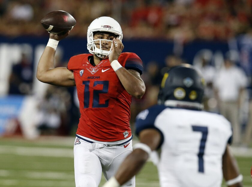 Arizona quarterback Anu Solomon (12) throws downfield against Northern Arizona during the first half of an NCAA college football game, Saturday, Sept. 19, 2015, in Tucson, Ariz. (AP Photo/Rick Scuteri)