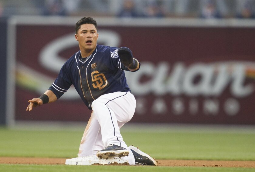 San Diego Padres host the Los Angeles Dodgers at Petco Park. Everth Cabrera is tagged out by Hanley Ramirez in the second inning and is unhappy with the call.