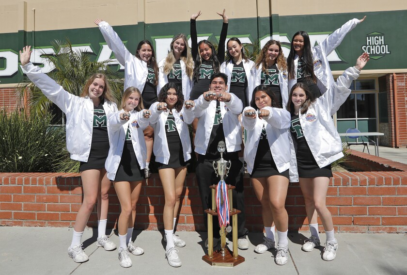 Members of the Costa Mesa High cheerleading team recently won at the Universal Cheerleaders Assn. High School Nationals.