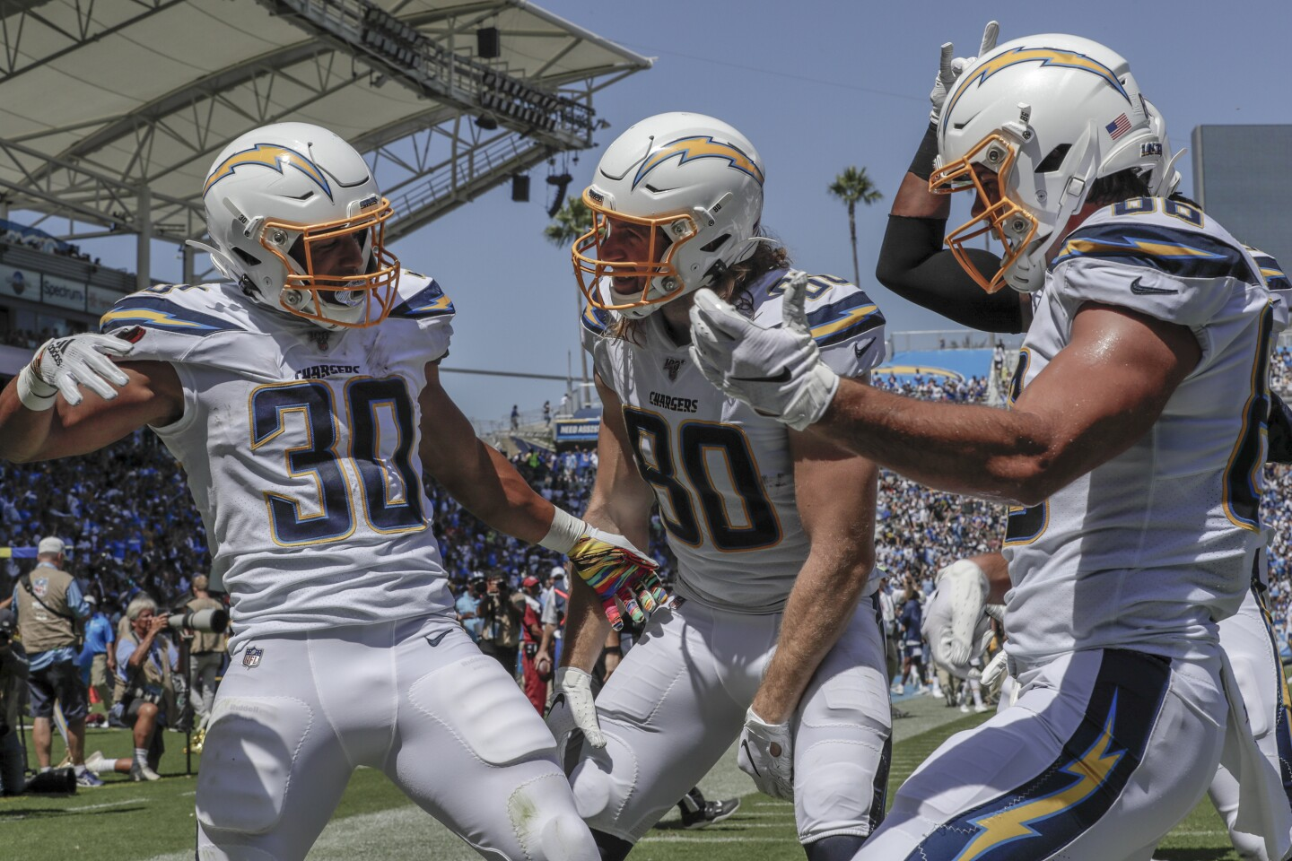 CARSON, CA, SUNDAY, SEPTEMBER 8, 2019 - Chargers running back Austin Ekeler celebrates a touchdown with teammates in the first quarter against the Colts at Dignity Health Sports Park. (Robert Gauthier/Los Angeles Times)