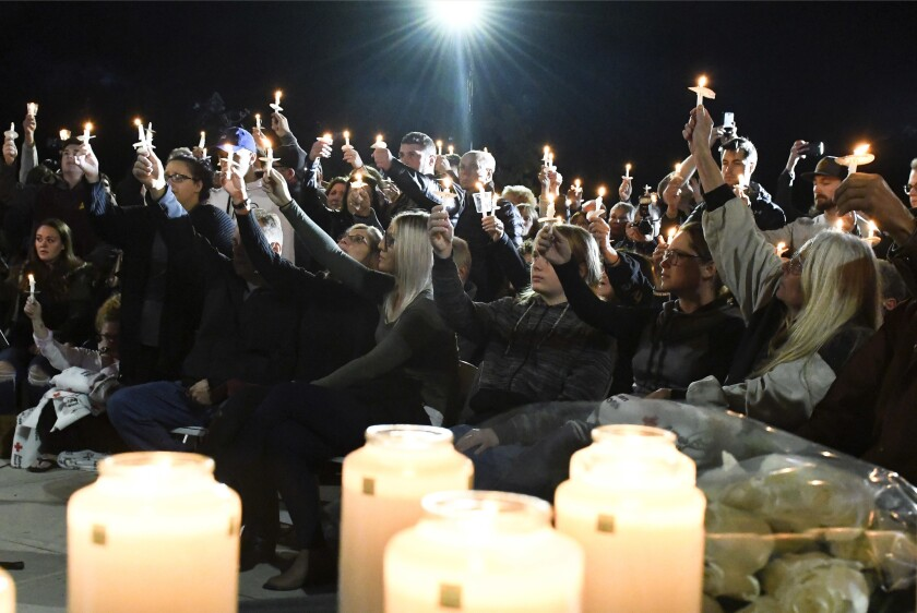 Family members and friends gather for a candlelight vigil memorial at Mohawk Valley Gateway Overlook Pedestrian Bridge in Amsterdam, N.Y., Monday, Oct. 8, 2018. The memorial honored 20 people who died in Saturday's fatal limousine crash in Schoharie, N.Y.