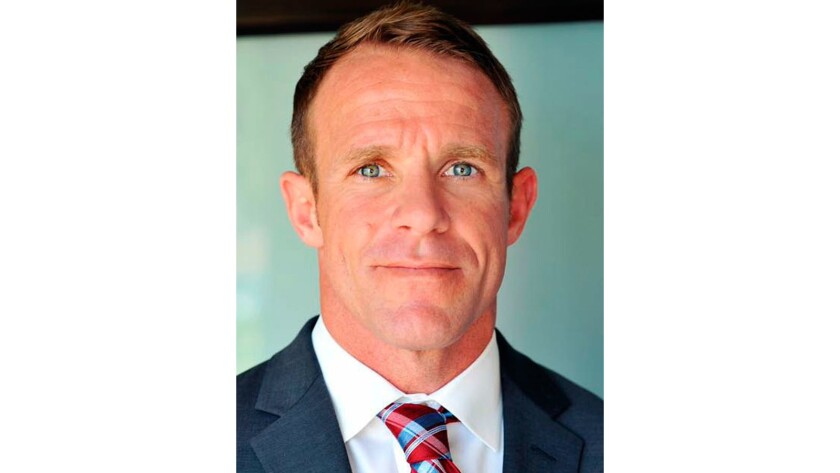 Trump steps in on behalf of Navy SEAL charged with war