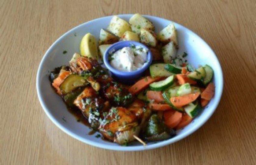 Teriyaki Salmon Grilled Kabobs with vegetables and potatoes