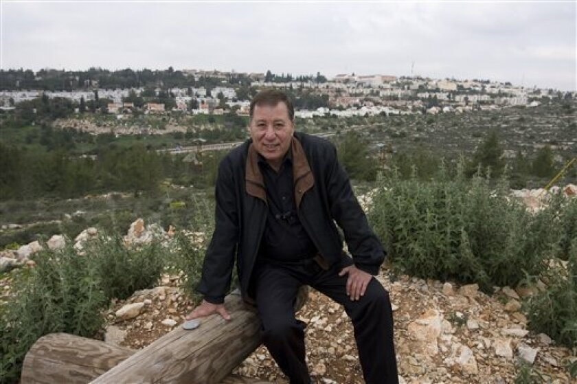 In this photo taken Tuesday, Feb. 2, 2010, Israeli mayor and founder of the West Bank Jewish settlement of Ariel, Ron Nachman, poses for a photo on the outskirts of Ariel. Ariel has ambitions of becoming a city, and is beginning to look like one, with its 19,000 people, its college and $10 million