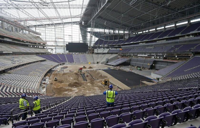 Members of the media take in a tour, Tuesday, Feb. 16, 2016, of the new U.S. Bank stadium in Minneapolis which will be home to the Minnesota Vikings NFL football team.  (AP Photo/Jim Mone)