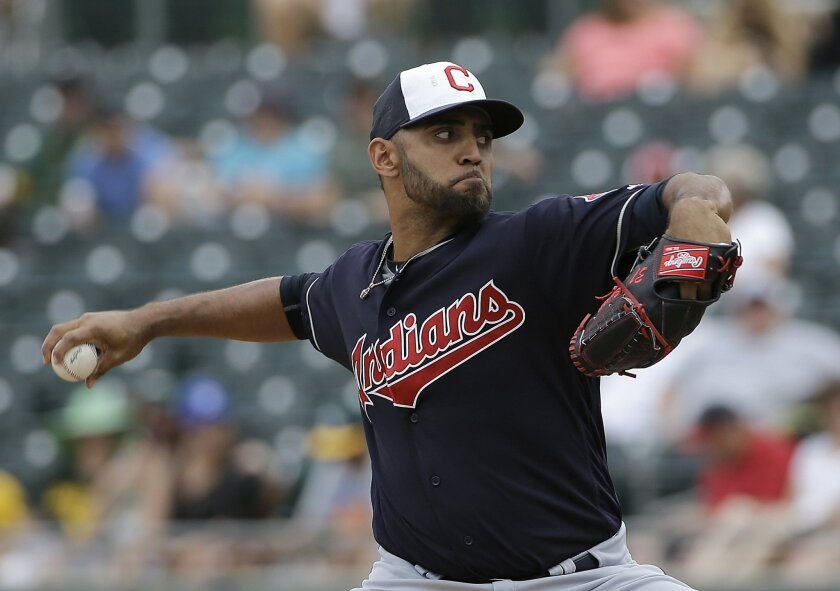 Cleveland Indians starting pitcher Danny Salazar throws against the Oakland Athletics during the first inning of a spring training baseball game in Mesa, Ariz., Monday, March 28, 2016. (AP Photo/Jeff Chiu)