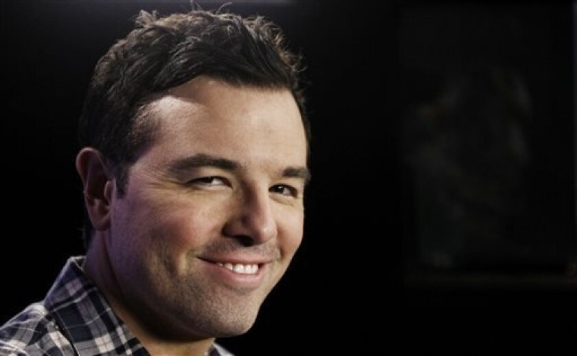 """In this Saturday, Oct. 1, 2011 photo, Seth MacFarlane poses for a portrait in Los Angeles. Fox, facing the ebbing ratings power of """"American Idol,"""" is betting big on its first miniseries and shows from heavyweight producers MacFarlane and J.J. Abrams to invigorate its schedule. The network is making its largest original-programming investment yet with a crop of 11 new series along with the miniseries from filmmaker M. Night Shyamalan for the 2013-14 season, Kevin Reilly, Fox Entertainment chairm"""
