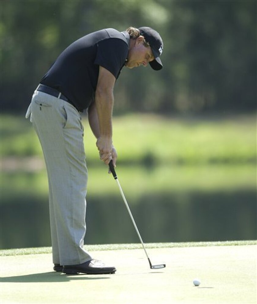 Phil Mickelson birdies on the ninth hole during the first round of the Houston Open PGA Tour golf tournament on Thursday, March 31, 2011, in Humble, Texas. (AP Photo/Bob Levey)